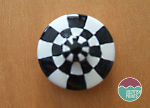 Painting a checkered lid.