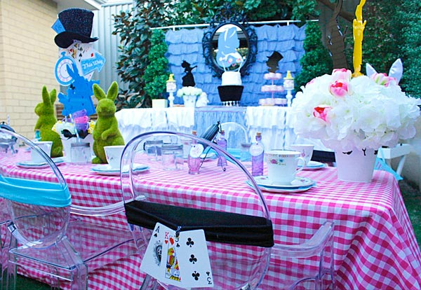 Alice in Wonderland party seating with playing card decorations.