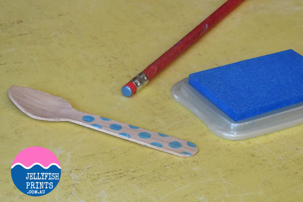 Stamping dots onto the spoons.