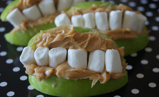 healthy Halloween treat made with apples, peanut butter and marshmallows.